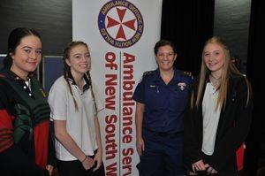 Students learning about ambulance services