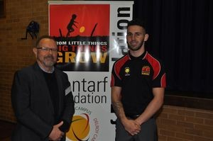 Two Contarf Academy Counsellors standing in front of a banner