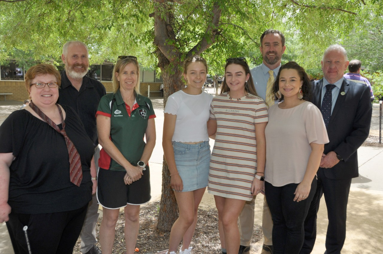 Dubbo College graduates Alex Lindsay and Lauren Cook (centre) with their teachers Kerrie Walters, Mark Skinner, Bec May, James Eddy, Lucy Burns and principal Andrew Jones.